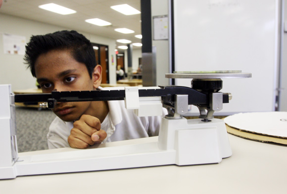 Metro High School Freshman Sujit Rao works on a lab project. Photos Ben French